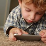 KID WITH MOBILE APP